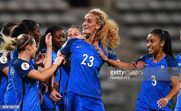 France's midfielder Kheira Hamraoui is congratuled by teammates after scoring a goal during the Women Euro 2017 qualifying football match France vs...
