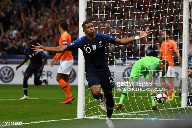 TOPSHOT France's midfielder Kylian Mbappe celebrates after scoring a goal during the UEFA Nations League football match between France and...