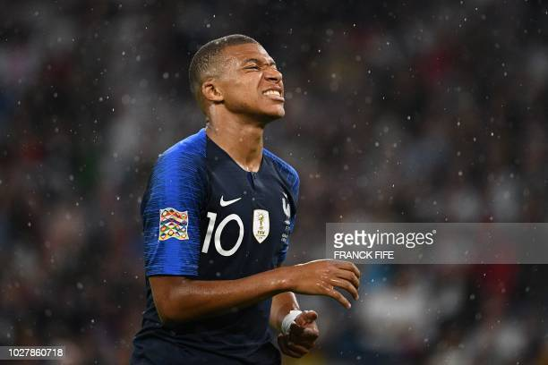 France's midfielder Kylian Mbappe reacts during the UEFA Nations League football match Germany against France on September 6 2018 at the Allianz...