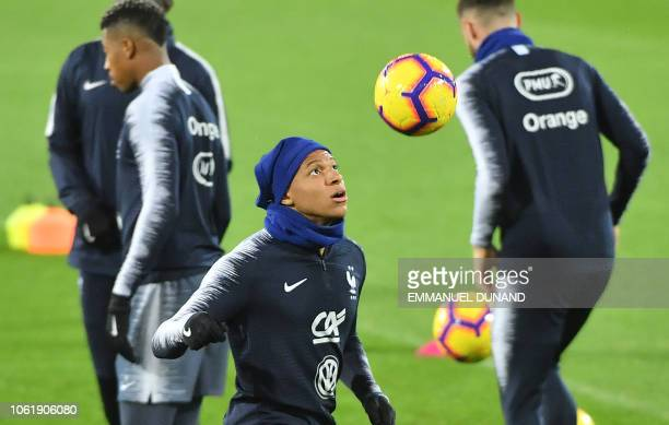 France's midfielder Kylian Mbappe takes part in a training session ahead of the UEFA Nations League football match between Netherlands and France at...