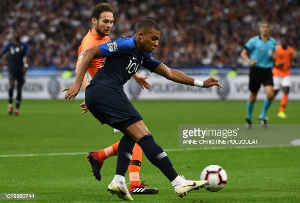France's midfielder Kylian Mbappe vies for the ball with Netherlands' defender Daley Blind uring the UEFA Nations League football match between...