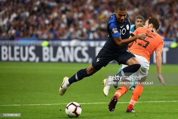 France's midfielder Kylian Mbappe vies for the ball with Netherlands' defender Daley Blind during the UEFA Nations League football match between...
