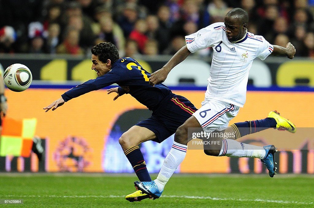 France's midfielder Lassana Diarra (R) tackles Spain's Jesus Navas during a friendly international football match at the stade de France in Paris on March 3, 2010.
