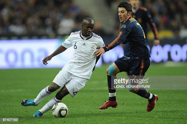 France's midfielder Lassana Diarra tries to pass Spain's forward David Villa during a friendly international football match at the stade de France in...