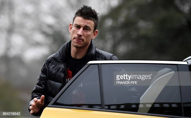France's midfielder Laurent Koscielny arrives at the French national football team training base in ClairefontaineenYvelines on March 19 as part of...
