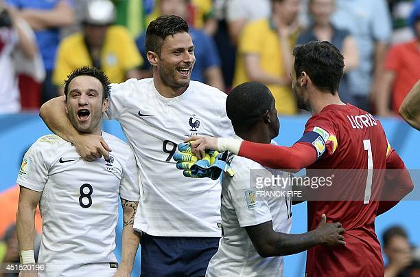 France's midfielder Mathieu Valbuena and France's forward Olivier Giroud celebrate at the end of the round of 16 football match between France and...