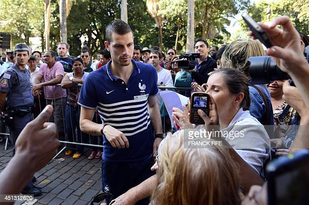 France's midfielder Morgan Schneiderlin arrives for a press conference at the theater in Ribeirao Preto on June 27 during the 2014 FIFA World Cup in...
