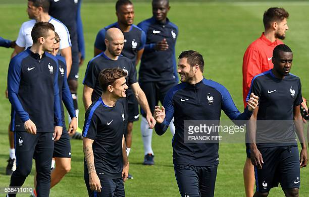 France's midfielder Morgan Schneiderlin forward Antoine Griezmann defender Christophe Jallet forward Andre Pierre Gignac and midfielder Blaise...