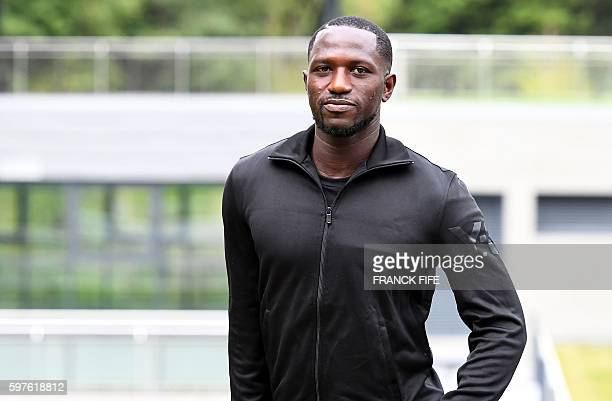 France's midfielder Moussa Sissoko arrives to the French national football team training base in Clairefontaine on August 29 as part of the team's...