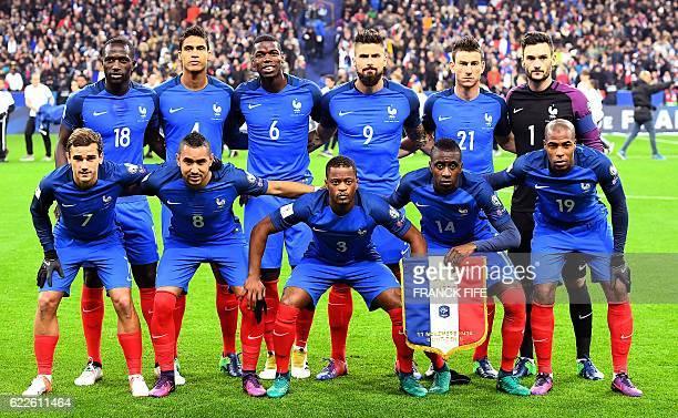 France's midfielder Moussa Sissoko defender Raphael Varane midfielder Paul Pogba forward Olivier Giroud defender Laurent Koscielny and goalkeeper...