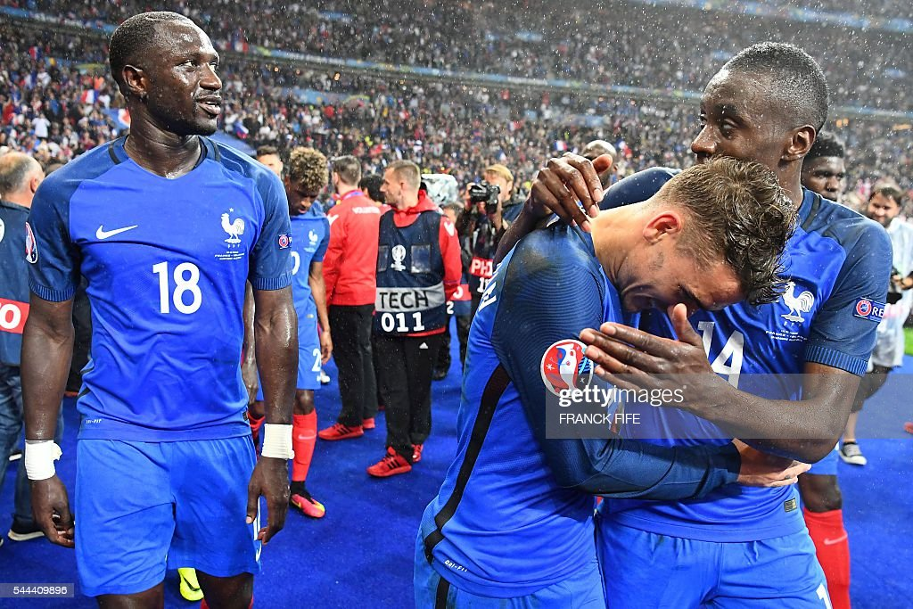 France's midfielder Moussa Sissoko, France's forward Antoine Griezmann and France's midfielder Blaise Matuidi celebrate after France beat Iceland 5-2 in the Euro 2016 quarter-final football match between France and Iceland at the Stade de France in Saint-Denis, near Paris, on July 3, 2016. FIFE