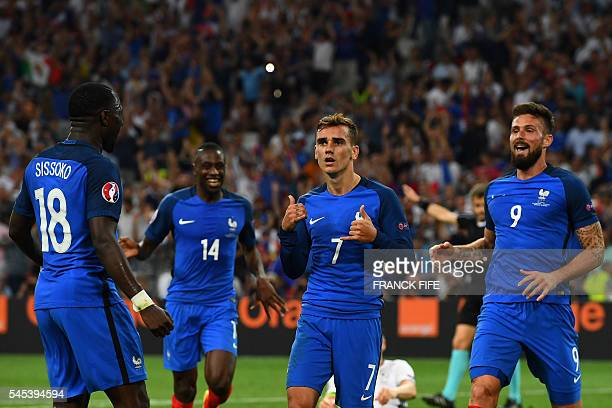 France's midfielder Moussa Sissoko France's midfielder Blaise Matuidi and France's forward Olivier Giroud celebrate after France's forward Antoine...