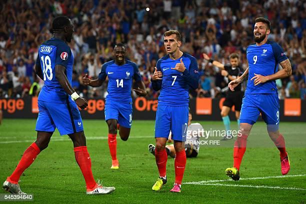 France's midfielder Moussa Sissoko France's midfielder Blaise Matuidi and France's forward Olivier Giroud celebrate after France's forward Antoine...