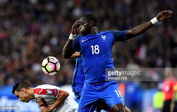 France's midfielder Moussa Sissoko jumps for the ball during the FIFA World Cup 2018 qualifying football match France vs Bulgaria on October 7 2016...