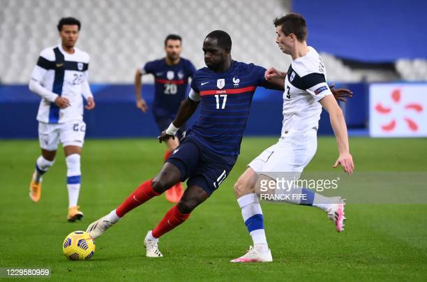 France's midfielder Moussa Sissoko vies for the ball with Finland's defender Daniel O'Shaughnessy during the friendly football match between France...