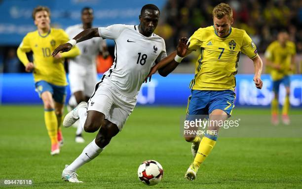 France's midfielder Moussa Sissoko vies with Sweden's midfielder Sebastian Larsson during the FIFA World Cup 2018 qualifying football match Sweden vs...