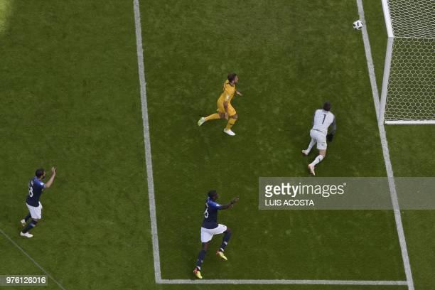 TOPSHOT France's midfielder Nabil Fekir and France's midfielder Paul Pogba celebrate after scoring past Australia's goalkeeper Mathew Ryan during the...