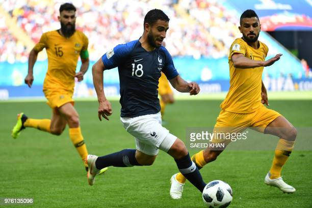 France's midfielder Nabil Fekir vies with Australia's defender Aziz Behich during the Russia 2018 World Cup Group C football match between France and...