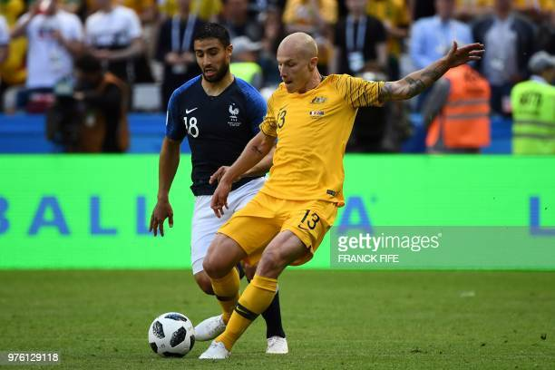 France's midfielder Nabil Fekir vies with Australia's midfielder Aaron Mooy during the Russia 2018 World Cup Group C football match between France...