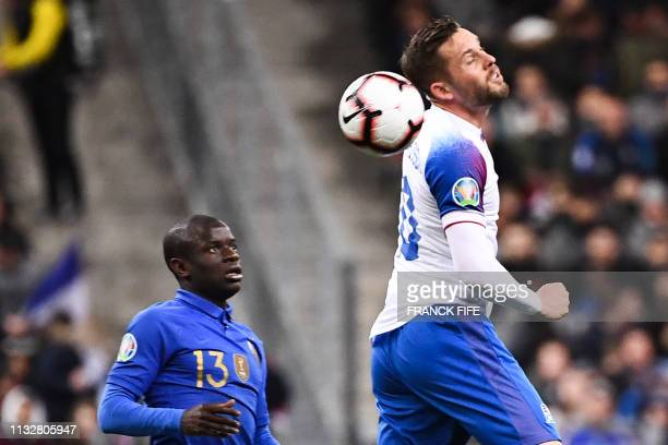 France's midfielder N'Golo Kante and Iceland's midfielder Gylfi Sigurdsson vie the ball during the UEFA Euro 2020 Group H qualification football...