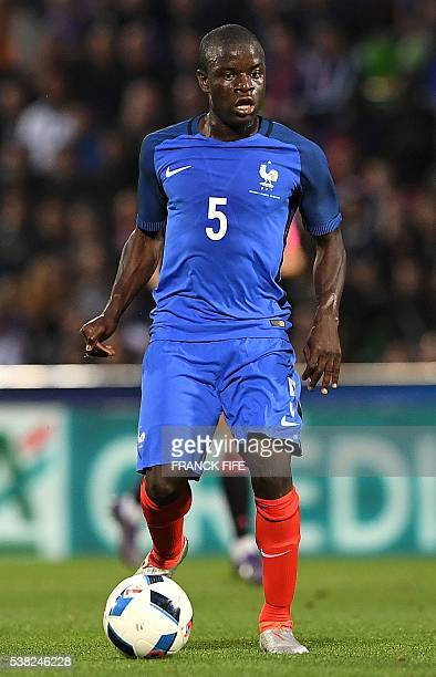 France's midfielder N'Golo Kante drives the ball during the friendly football match between France and Scotland, at the St Symphorien Stadium in...