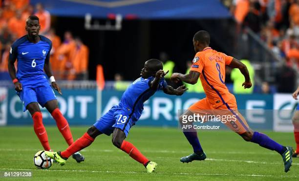 France's midfielder N'Golo Kante fights for the ball with Netherlands' midfielder Georginio Wijnaldum during the 2018 FIFA World Cup qualifying...