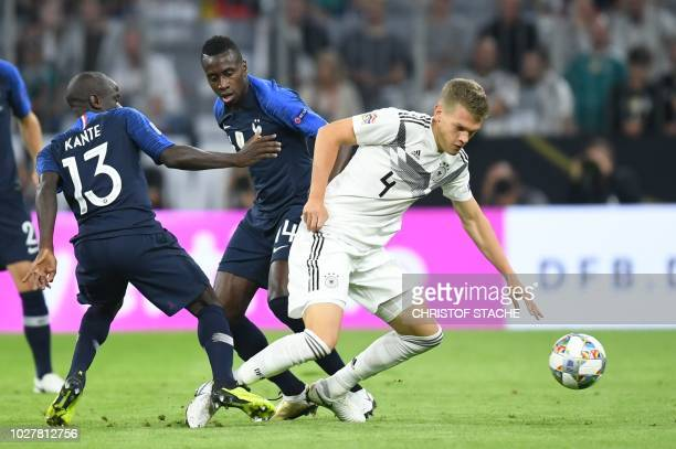 France's midfielder N'Golo Kante France's midfielder Blaise Matuidi and Germany's defender Matthias Ginter vie for the ball during the UEFA Nations...