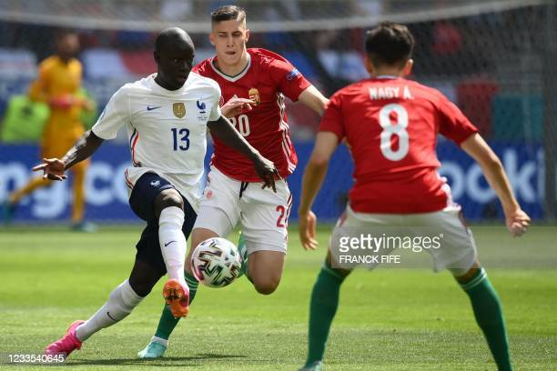 France's midfielder N'Golo Kante mand Hungary's forward Roland Sallai vie for the ball during the UEFA EURO 2020 Group F football match between...