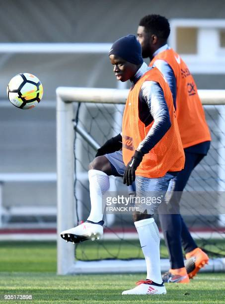France's midfielder N'Golo Kante plays the ball during a training session in Clairefontaine en Yvelines on March 20 as part of the team's preparation...