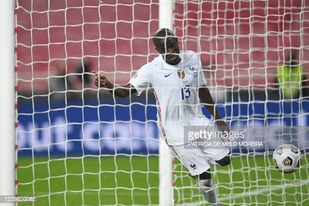 France's midfielder N'Golo Kante scores a goal during the UEFA Nations League A group 3 football match between Portugal and France at the Luz stadium...
