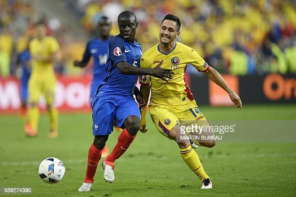 France's midfielder N'Golo Kante vies for the ball with Romania's forward Florin Andone during the Euro 2016 group A football match between France...