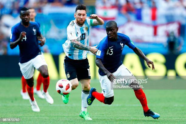 France's midfielder N'Golo Kante vies with Argentina's forward Lionel Messi during the Russia 2018 World Cup round of 16 football match between...