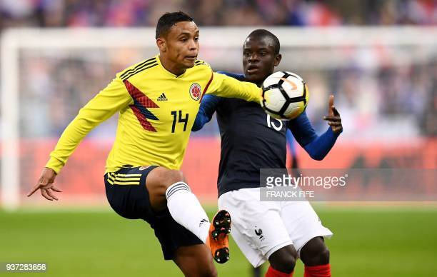 France's midfielder N'Golo Kante vies with Colombia's forward Luis Fernando Muriel during the friendly football match between France and Colombia at...