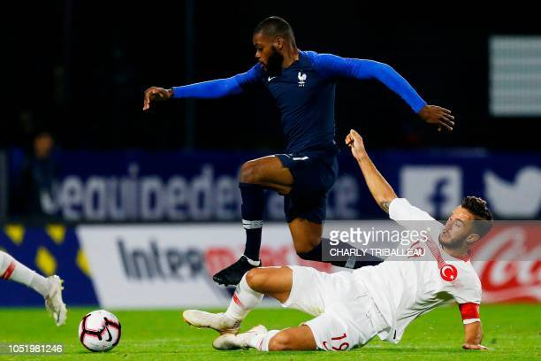 France's midfielder Olivier Ntcham vies for the ball with Turkey's forward Ogulcan Caglayan during the friendly under21 football match between France...