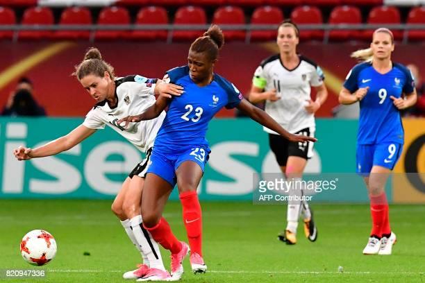 France's midfielder Onema Grace Geyoro vies with Austria's forward Nina Burger during the UEFA Women's Euro 2017 football tournament between France...