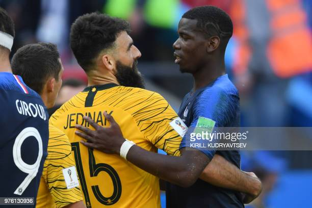 TOPSHOT France's midfielder Paul Pogba and Australia's midfielder Mile Jedinak exchange an embrace following the Russia 2018 World Cup Group C...
