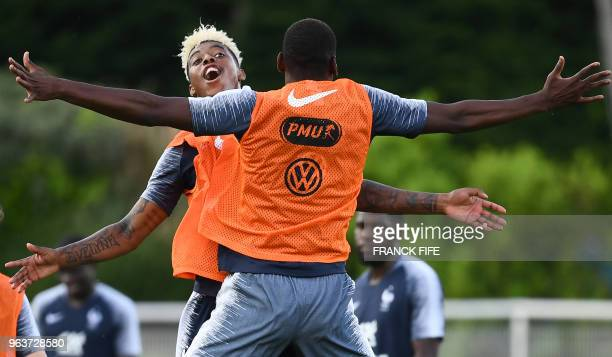 France's midfielder Paul Pogba and France's defender Presnel Kimpembe joke at the end of a training session in Clairefontaine en Yvelines on May 30...