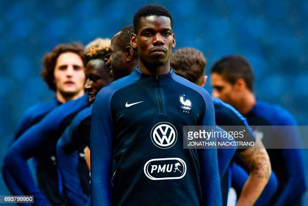 France's midfielder Paul Pogba attends a training session of the French national football team on the eve of the WC 2018 football qualification match...
