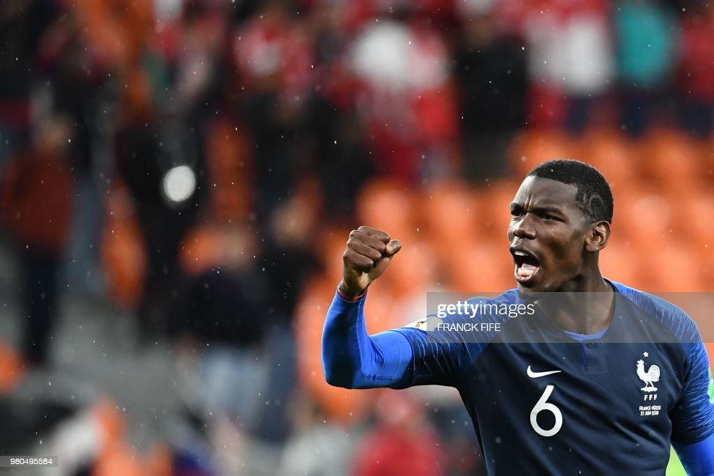 TOPSHOT - France's midfielder Paul Pogba celebrates after winning at the end of the Russia 2018 World Cup Group C football match between France and Peru at the Ekaterinburg Arena in Ekaterinburg on June 21, 2018. (Photo by FRANCK FIFE / AFP) / RESTRICTED