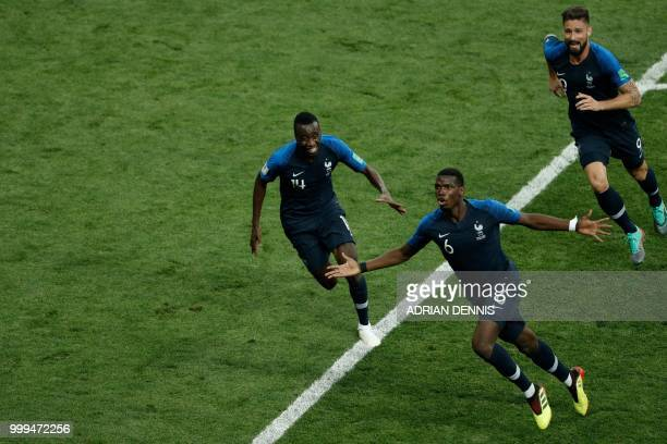 TOPSHOT France's midfielder Paul Pogba celebrates with France's midfielder Blaise Matuidi and France's forward Olivier Giroud after scoring a goal...