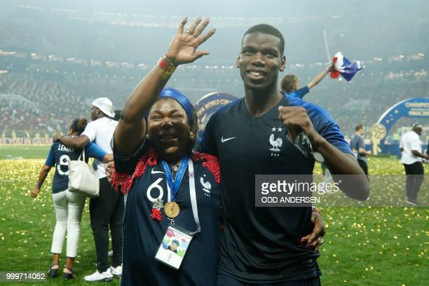 France's midfielder Paul Pogba celebrates with his mother after the World Cup trophy after the Russia 2018 World Cup final football match between...