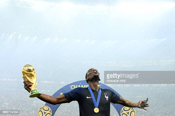 France's midfielder Paul Pogba celebrates with the World Cup trophy after the Russia 2018 World Cup final football match between France and Croatia...