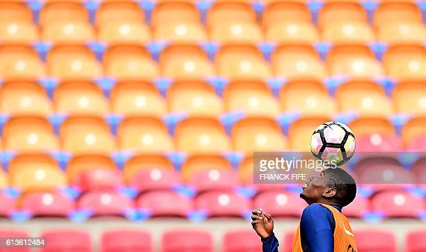 France's midfielder Paul Pogba controls the ball as he eyes it during a training session at the Amsterdam Arena in Amsterdam on October 9 on the eve...