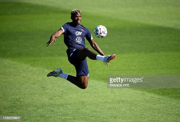 France's midfielder Paul Pogba controls the ball during a training session in Clairefontaine-en-Yvelines on May 31, 2021 as part of the team's...