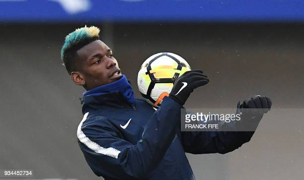 TOPSHOT France's midfielder Paul Pogba controls the ball during a training session in ClairefontaineenYvelines southwest of Paris on March 19 as part...