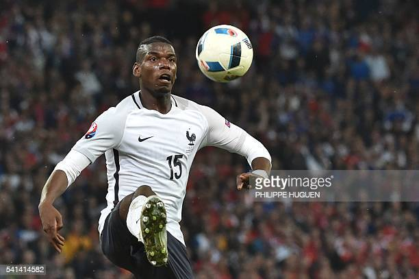 France's midfielder Paul Pogba controls the ball during the Euro 2016 group A football match between Switzerland and France at the PierreMauroy...