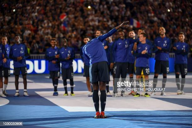 France's midfielder Paul Pogba dabs during a ceremony before the lap of honour at the end of the UEFA Nations League football match between France...