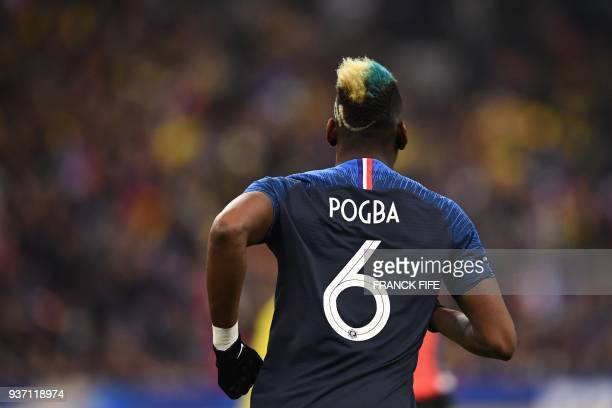 France's midfielder Paul Pogba enters the football picth to play during the friendly football match between France and Colombia at the Stade de...