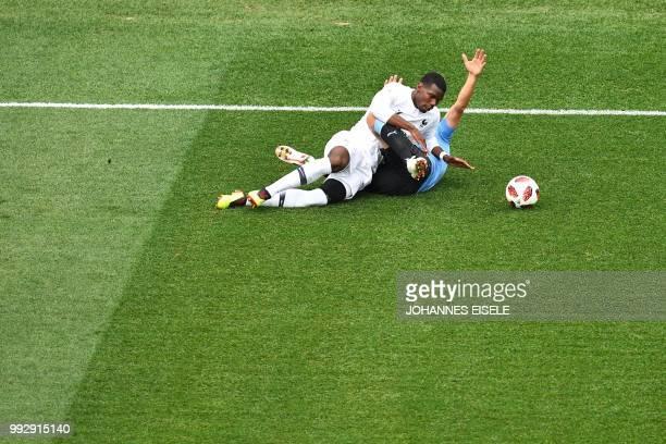 TOPSHOT France's midfielder Paul Pogba fouls Uruguay's forward Cristhian Stuani during the Russia 2018 World Cup quarterfinal football match between...