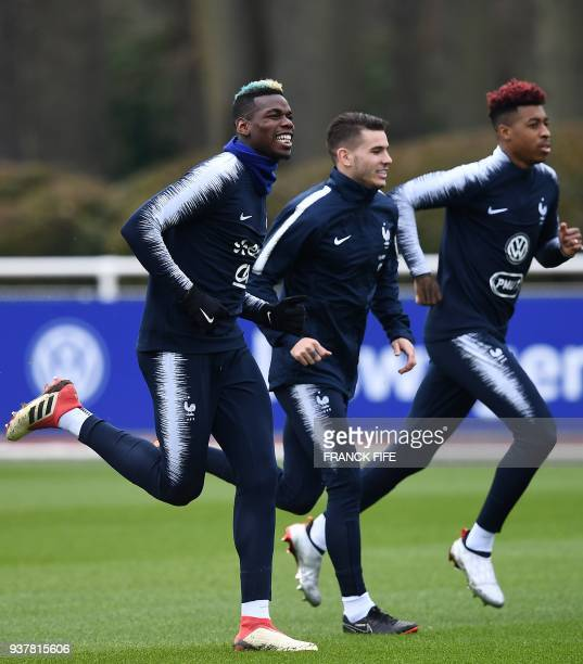 France's midfielder Paul Pogba France's defender Lucas Hernandez and France's defender Presnel Kimpembe take part in a training session in...